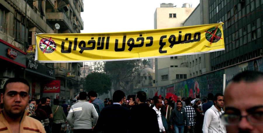 "Banner in Tahrir by Mohamed Mahmoud St reads ""Muslim Brotherhood Forbidden Entry"""